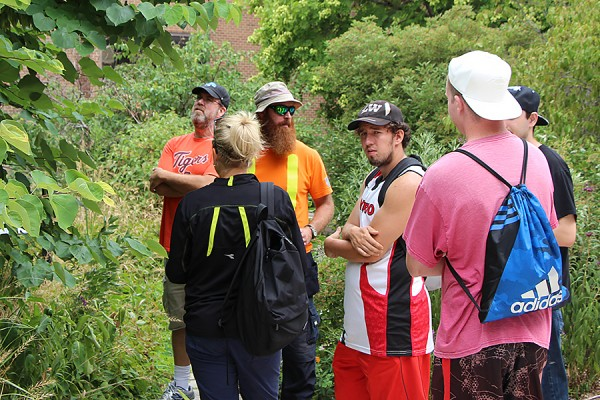 UWindsor gardener Aaron Dickau shows St. Clair College horticulture students and instructors the diversity of native species in the Stewart Moore Carolinian Garden.