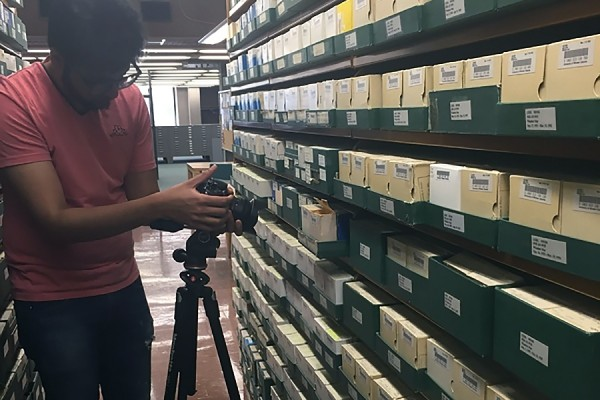 Anushray Singh films footage in the Leddy Library.
