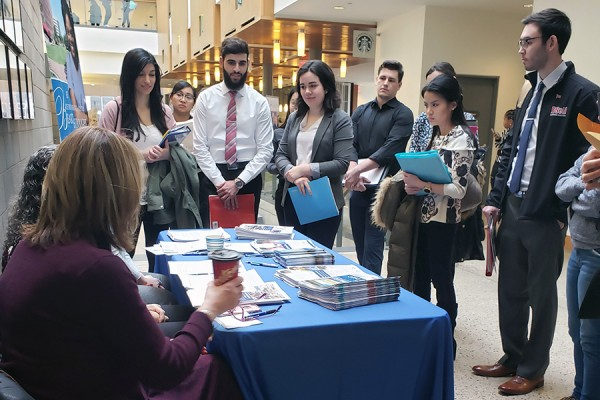 Nursing Career Fair - students gather around potential emploer's table