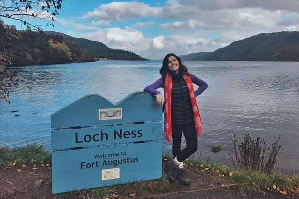 Olivia Sanders standing next to Loch Ness