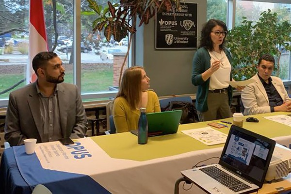 Social work professor Cynthia Stirbys speaks with students at a workshop Oct. 22 in the OPUS offices.
