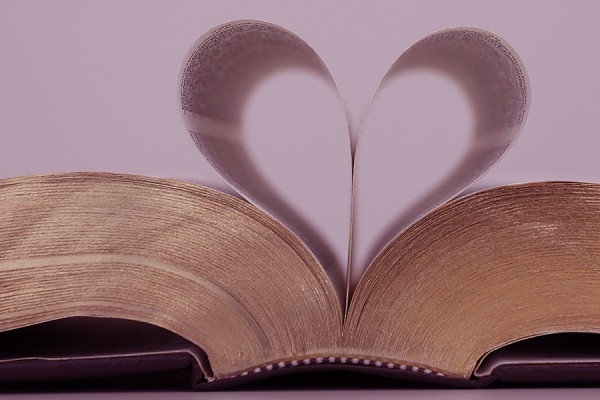 book with pages folded to form heart shape