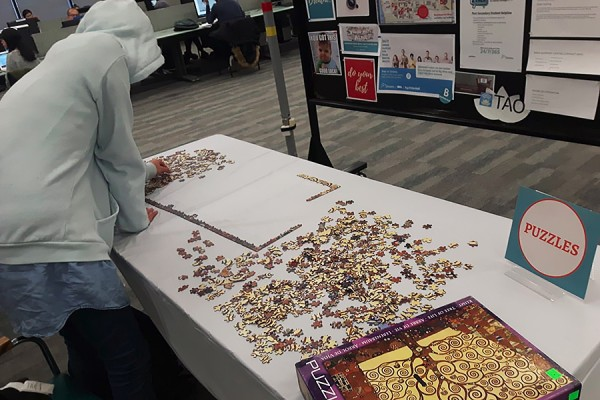 student working on jigsaw puzzle