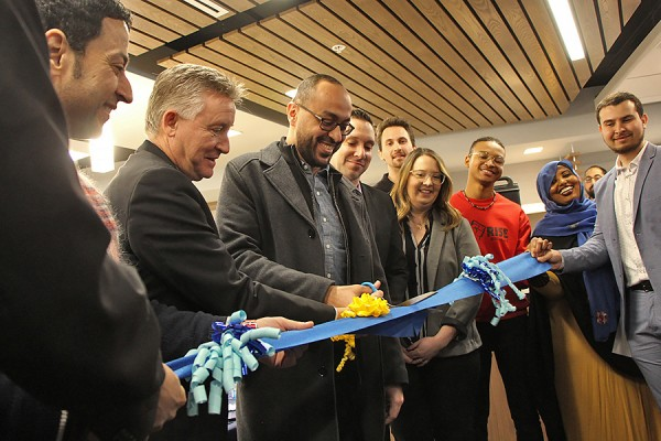 UWindsor students and officials cut a ribbon.