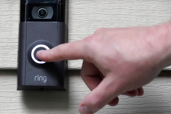 finger on doorbell