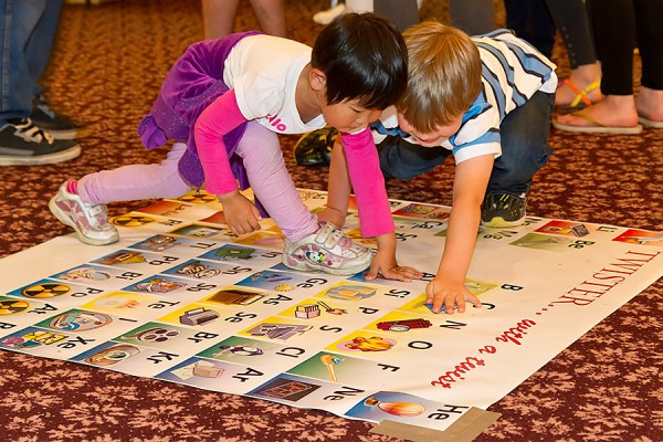 toddlers playing Twister on a periodic table of elements