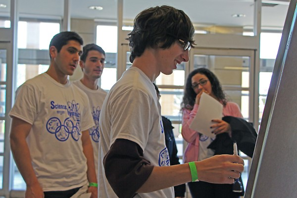 Assumption catholic high school students raced to finish a science pictionary challenge in Science Olympiad.