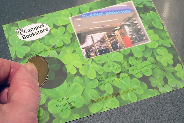 hand scatching ticket covered with clovers