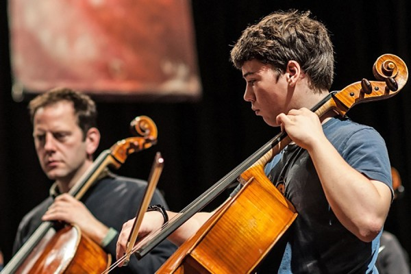 student and professional cellists perform side by side