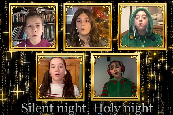 "Screen of children singing ""Silent Night"""