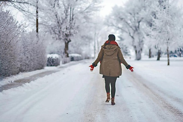 person walking in snowscape