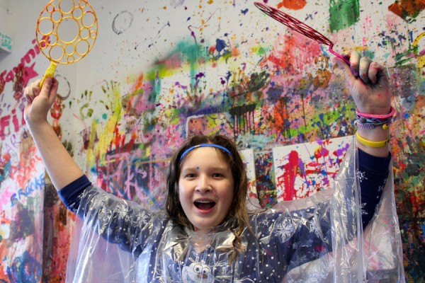 young person happy in splatter room