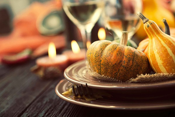table set with autumnal gourds and such