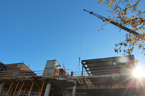 crane lifting material to top of science building under construction