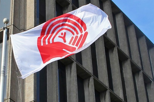 United Way flag flapping outside Chrysler Hall Tower