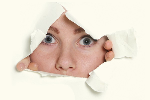 UWill Discover image - woman breaking through sheet of paper
