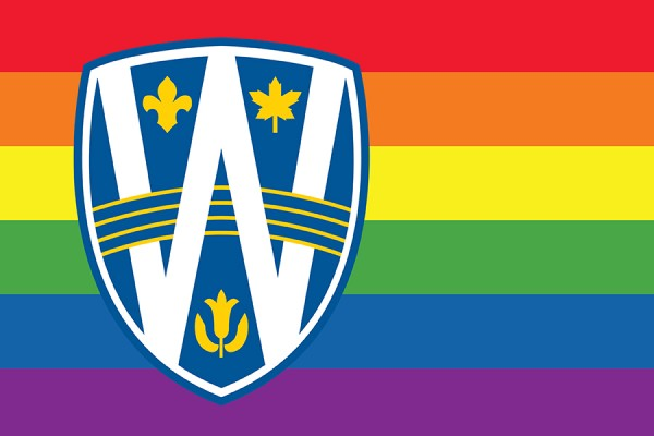 UWindsor logo shield over rainbow flag