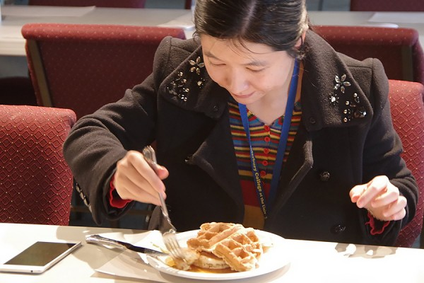 Nan Yang digs in to a plateful of waffles and pancakes