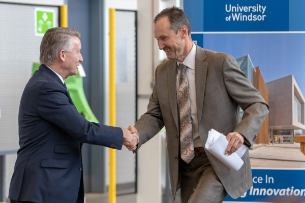 UWindsor interim president Douglas Kneale extends thanks to Windsor Mold CEO Keith Henry for a donation to the University's fundraising campaign.