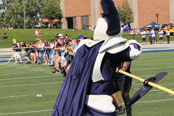 Lancer mascot Winston single-handedly holds off a team of tuggers-of-war.