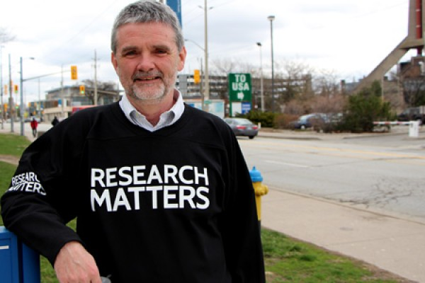 "Bill Anderson wearing ""Research Matters"" shirt."