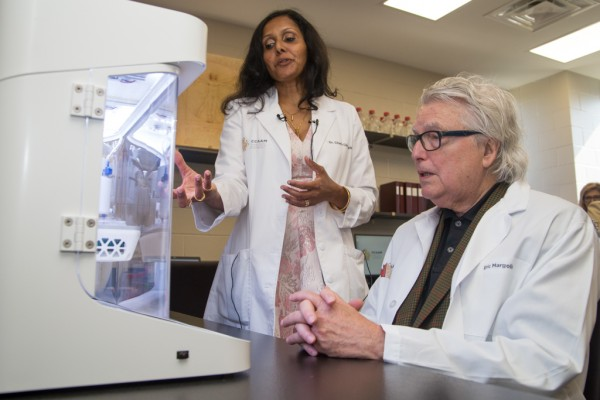 Dr. Charu Chandrasekera, Executive Director of the Canadian Centre for Alternatives to Animal Methods (CCAAM), explains to Eric Margolis how the lab utilizes 3D printing to produce replicas of human tissues and organs for research during CCAAM's grand ope