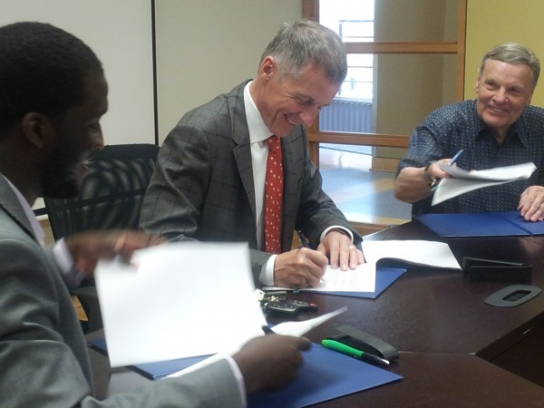 President Alan Wildeman, joined by UWindsor Student Alliance president Jaydee Tarpeh (l.) and Organization of Part Time University Students president Ed King (r.) signed an agreement to continue joint operation of CAW Student Centre, Tuesday.