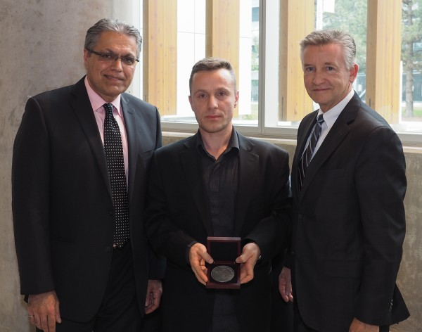 Dean Mehrdad Saif (l.) and Provost Douglas Kneale (r.) presented engineering professor Vesselin Stoilov (m.) with a medal, honouring him at the newly-established awards program that recognizes the contributions of faculty and staff.