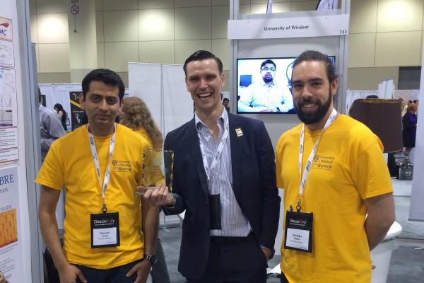 Kyle Bassett, middle, won the David McFadden Energy Entrepreneur Challenge at the Ontario Centres of Excellence Discovery Conference this week, for designing a small wind turbine that takes only a few hours to manufacture using low cost 3D printers. Pho