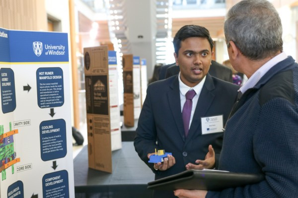 M. Eng student Neel Nitinkumar Shah describes his co-op experience at Windsor Mold Group during a poster presentation on Friday, Nov. 17, 2017