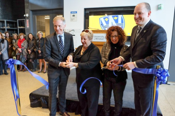 University of Windsor President Alan Wildeman, Marilyn Racotivis, Helena Ventrella and Drew Dilkens cut the ribbon at the grand opening of the School of Creative Arts' Freedom Way Building on March 22, 2018.