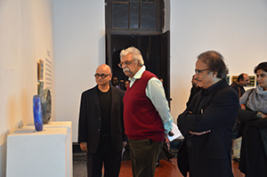 Amin Rehman with guests at his exhibition at the  Zahoor ul Akhlaq Gallery, National College of Art, Lahore, Pakistan