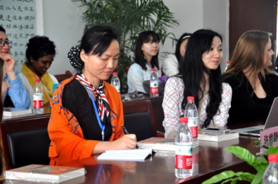 Dr. Xu with UW 2015 cohort at a local school in Chongqing