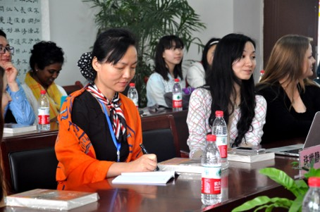 Dr. Xu presenting at a local school in Chongqing