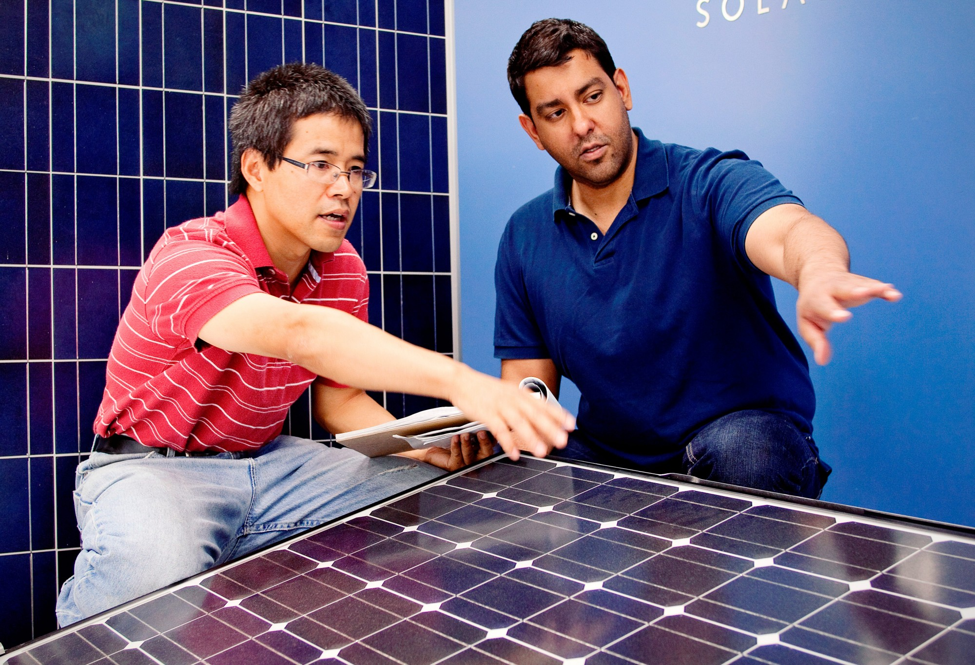 Engineering students discussing on solar panels.