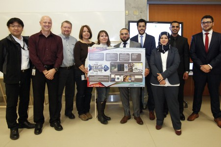 A team of industrial engineering students pose with industry partners TRQSS during capstone presentation day at the Ed Lumley Centre for Engineering Innovation.