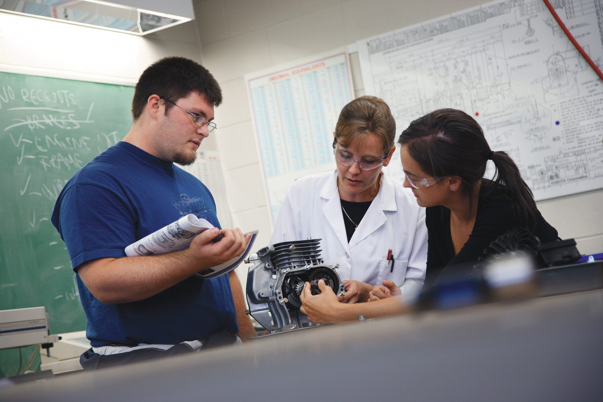 Students and professor in Automotive program