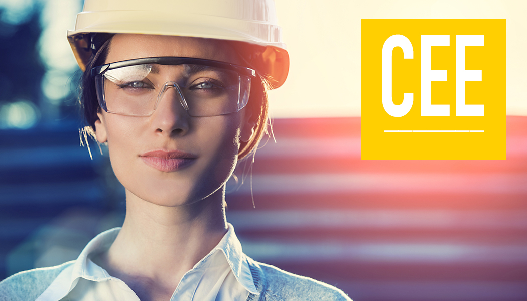 Female engineer wearing safety googles and hat.