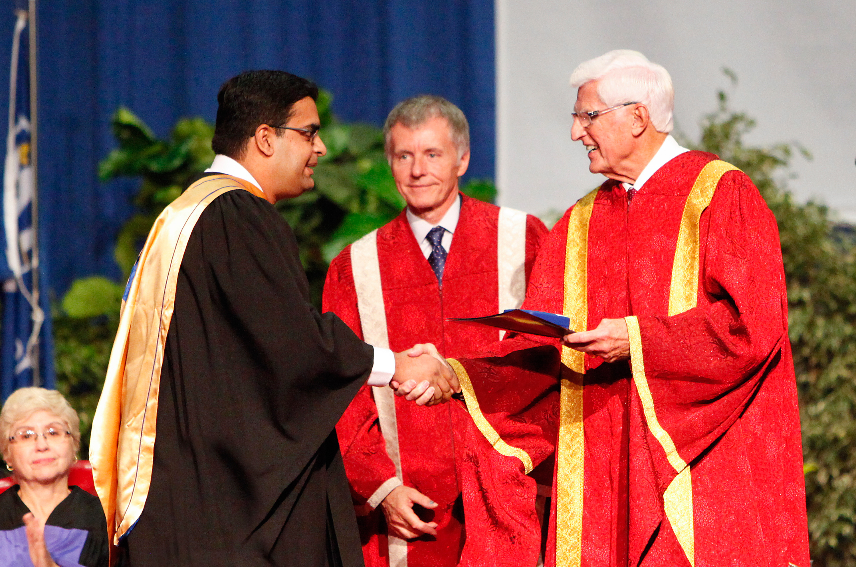 Lakshmi Varaha Iyer, a recipient of the Governor General's Gold Medal, receives congratulations from UWindsor president Alan Wildeman and chancellor Ed Lumley, Saturday at Convocation.