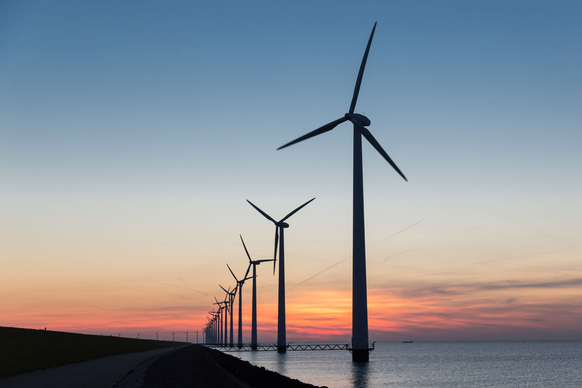Wind turbines line the coast