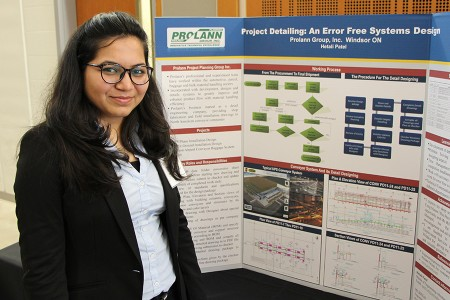 Hetali Patel displays her poster in the Ed Lumley Centre for Engineering Innovation.