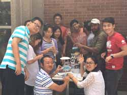 students constructing tower