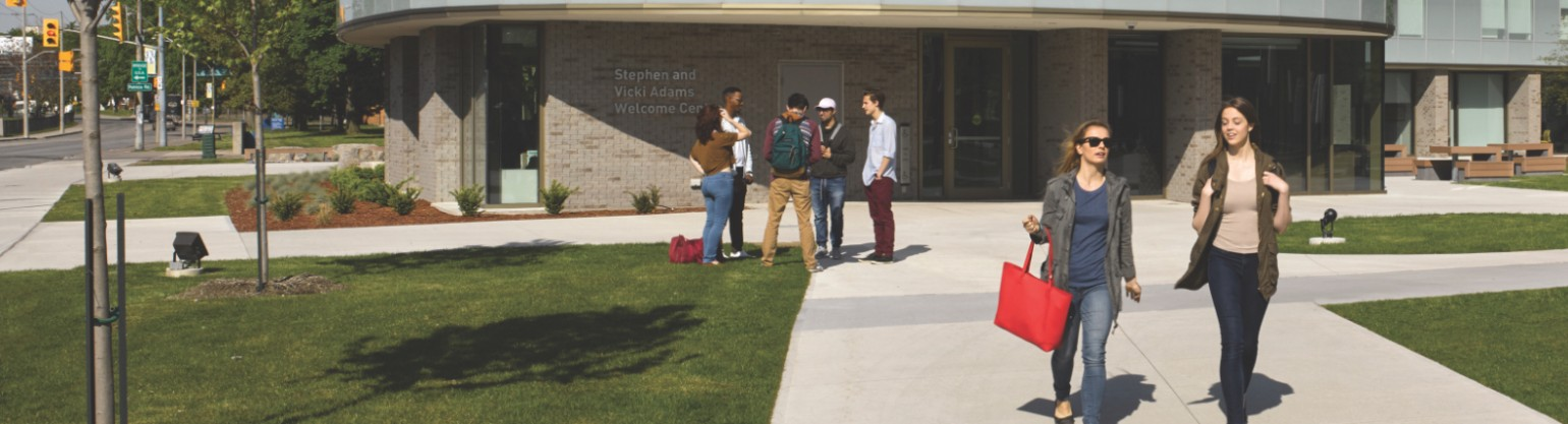 Students walking in front of the Welcome Centre