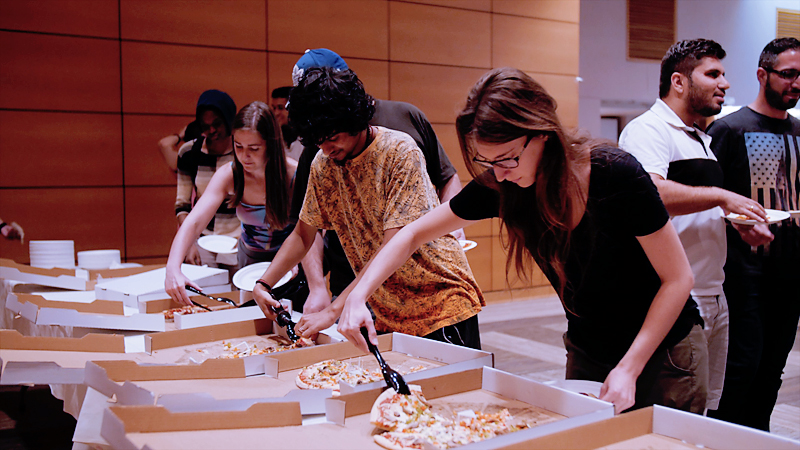 "Students load up on pizza at ""Pizza with the President"""