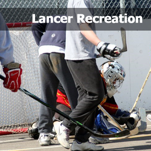 Students playing ball hockey