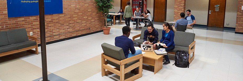 Students relaxing in lobby of residence