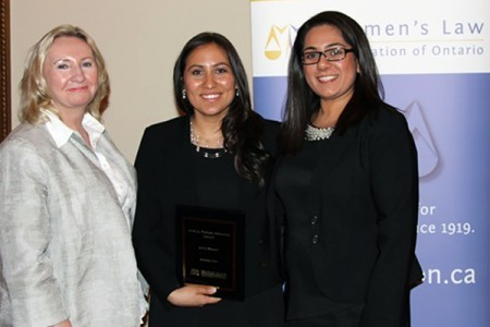 Sponsor Avril Farlam presents an award for clinic advocacy to Windsor Law graduand Emilia Coto, as Preet Singh, her supervisor at Legal Assistance of Windsor, looks on.