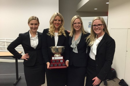 Walsh Family Moot team members Lesley Campbell, Mackenzie Falk, Rebecca Hines and Rebecca Locksley, along with their coach Cynthia Nantais
