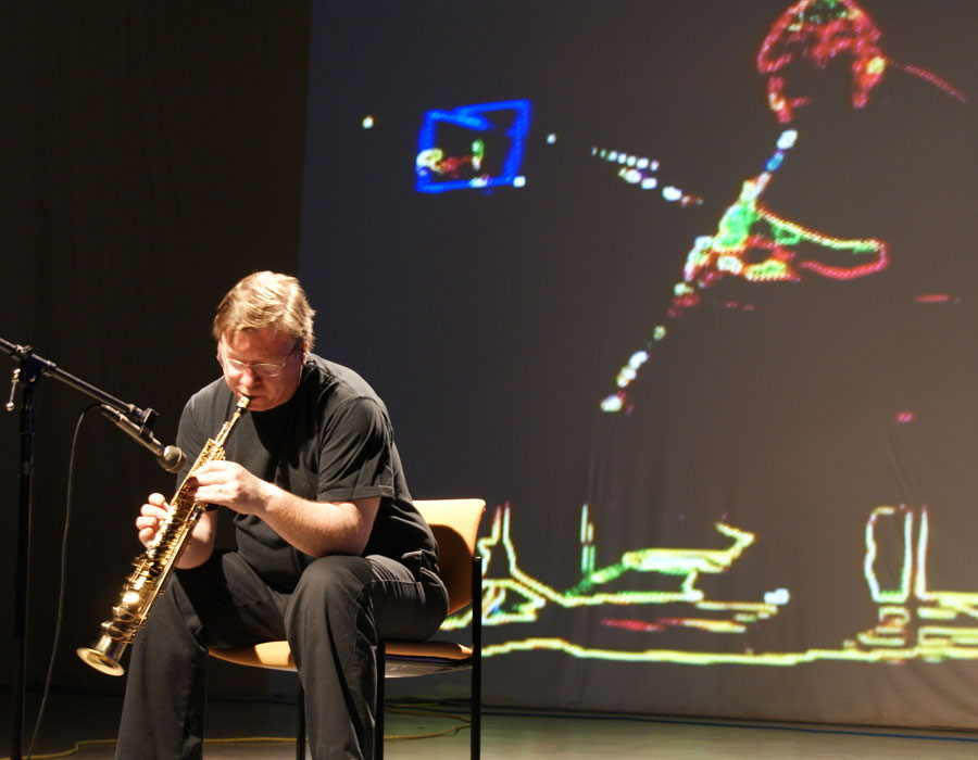 Brent Lee plays soprano saxophone during a Noiseborder Ensemble performance