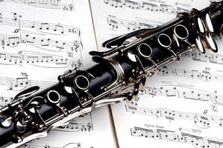 Clarinet laying on top of musical score